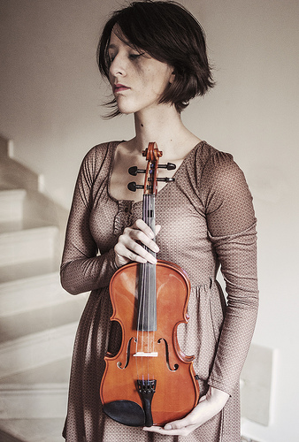 This woman obviously has been playing a violin.